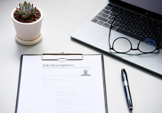 Job description paper in office Premium Photo