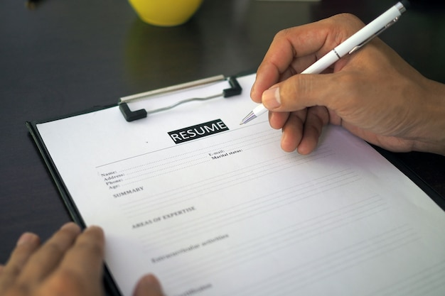 Job seekers, men are filling out a resume on the form. Premium Photo