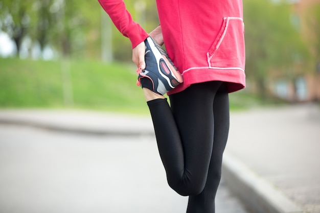 Jogger doing stretches before running practice. close-up Free Photo