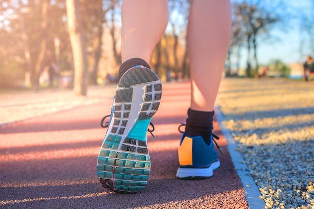 Jogging on a running track Premium Photo