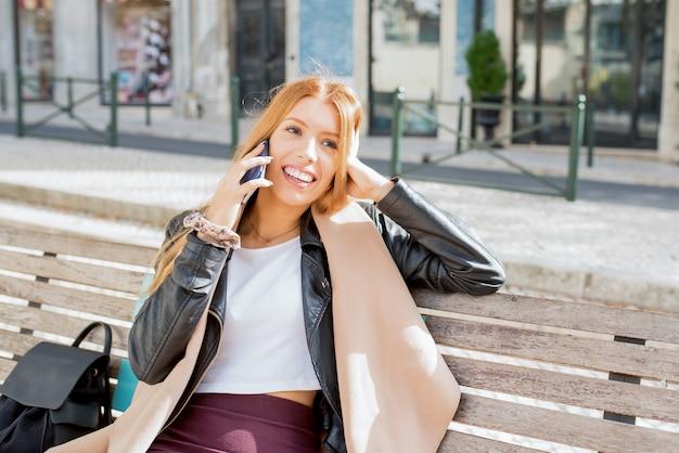 Jolly beautiful woman enjoying phone conversation Free Photo