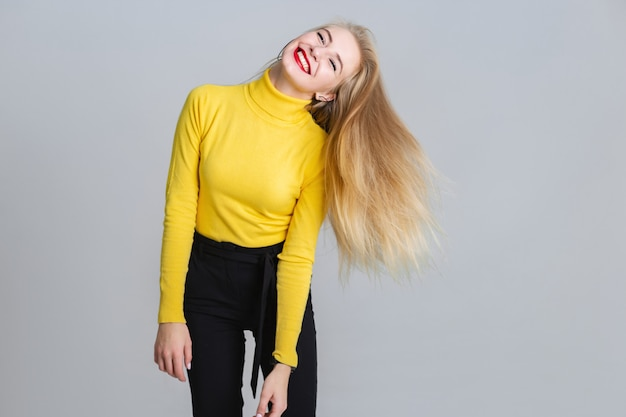 Joyful blonde woman have a fun in the studio. Premium Photo