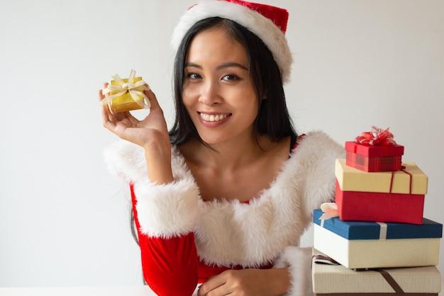 Joyful christmas girl showing small gift box Free Photo