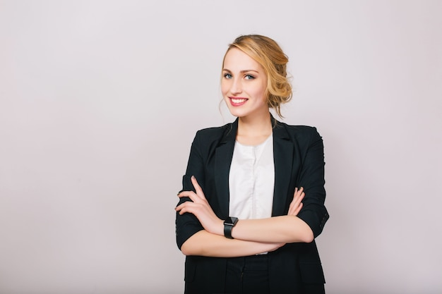 Joyful confident blonde businesswoman in suit smiling isolated. modern worker, secretary, executive, successful, cheerful mood. Free Photo
