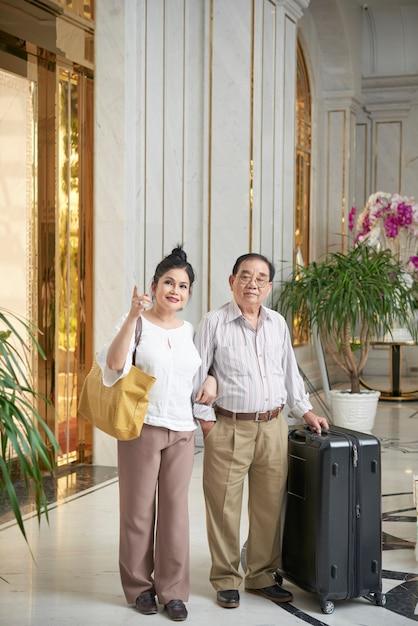 Joyful couple in hotel hall Free Photo