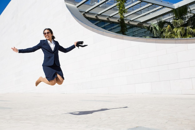 Joyful excited businesswoman celebrating success Free Photo