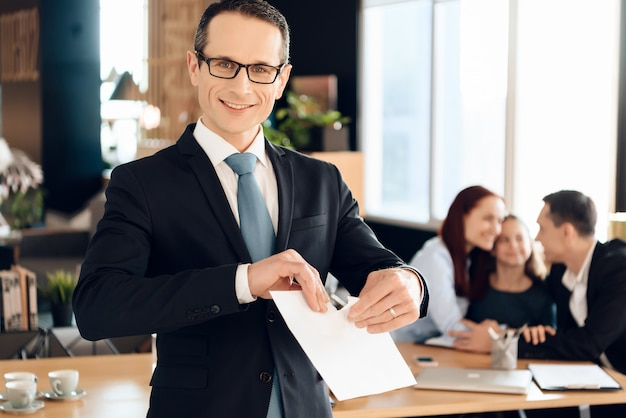Joyful family lawyer in suit tears paper. Premium Photo
