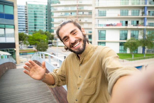 Joyful happy hipster guy taking selfie Free Photo