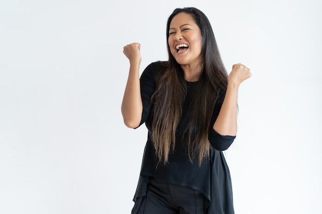 Joyful middle-aged woman celebrating success Free Photo