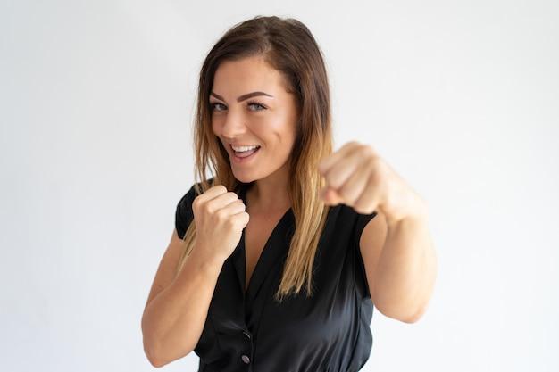 Joyful pretty woman standing in boxing pose Free Photo