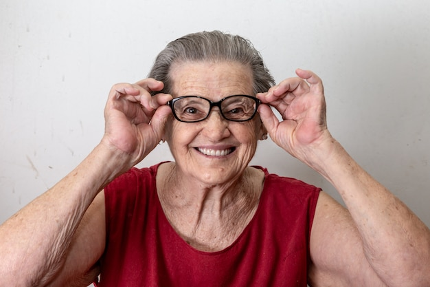Joyful senior lady in glasses laughing Premium Photo