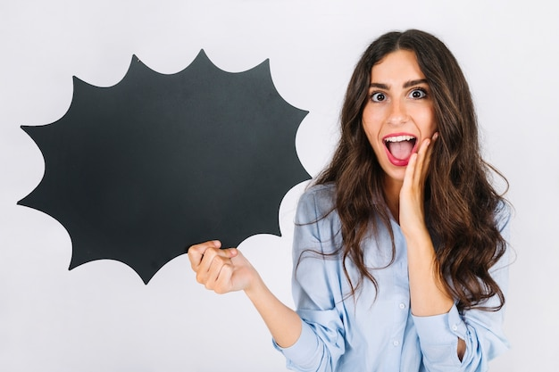 Joyful woman presenting speech bubble slate Free Photo