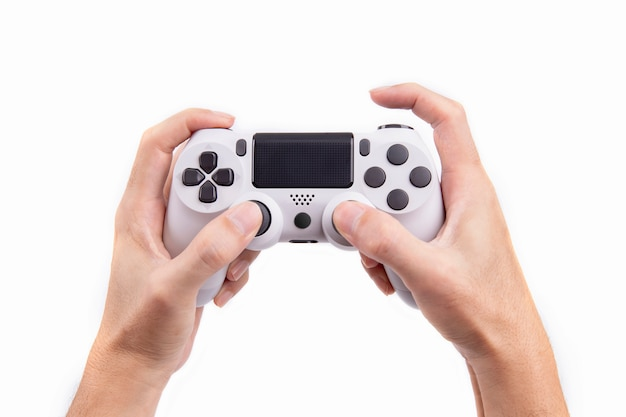 Joystick gaming controller in hand isolated on white background Premium Photo