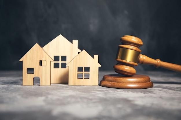 Judge gavel and house model. estate law concept Premium Photo