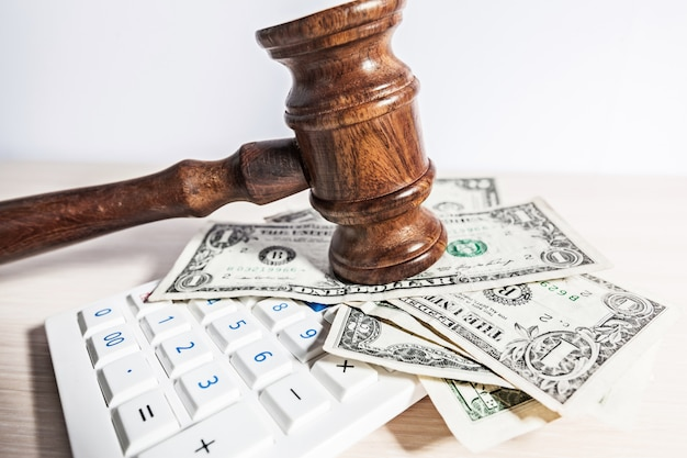 Judge gavel and money on brown wooden table concept Premium Photo