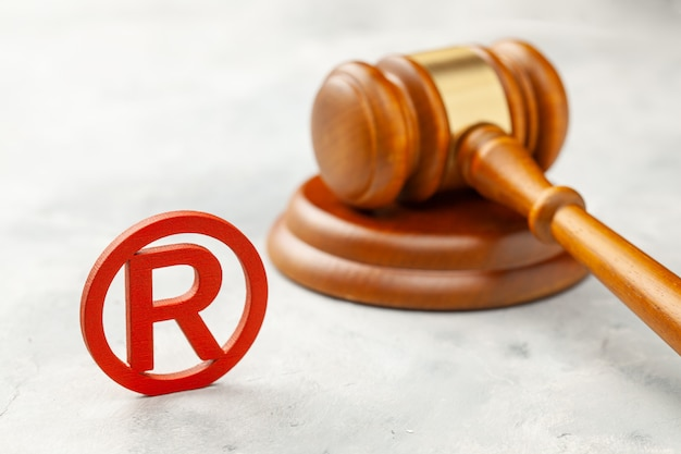 Judge gavel and red trademark sign Premium Photo