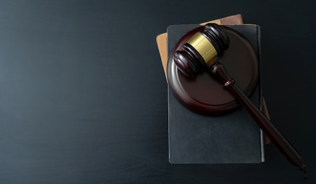 Judge gavel with books on wooden table Premium Photo