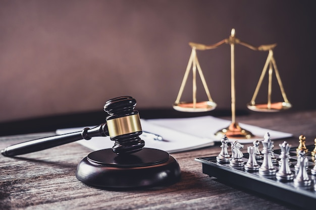 Judge gavel with justice lawyers, object documents working on table Premium Photo