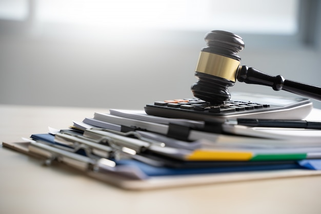 Judge hammer and business report papers, important documents Premium Photo