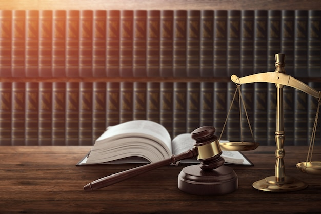 Judge's gavel and a book on a wooden table Premium Photo