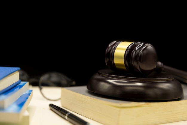 Judges gavel on book and wooden table. law and justice concept background. Free Photo