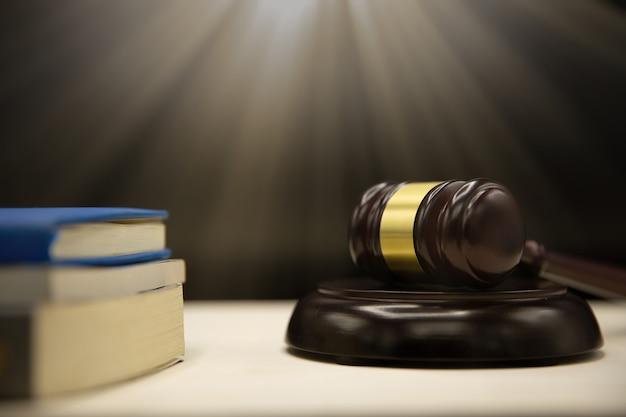 Judges gavel and book on wooden table. law and justice concept background. Free Photo