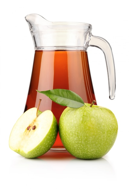 Jug and glass of green apple juice with fruit isolated Premium Photo