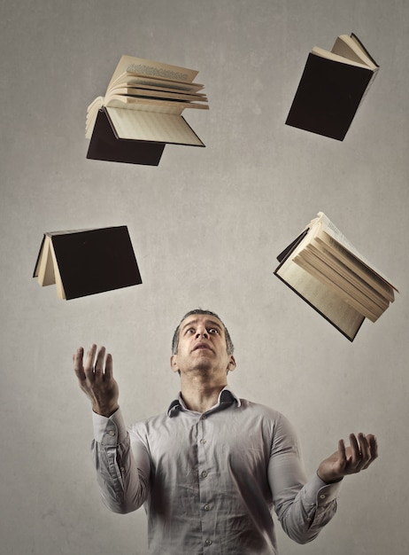 Juggling with books Premium Photo
