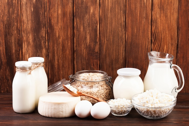Jugs of milk and dairy products arrangement Free Photo