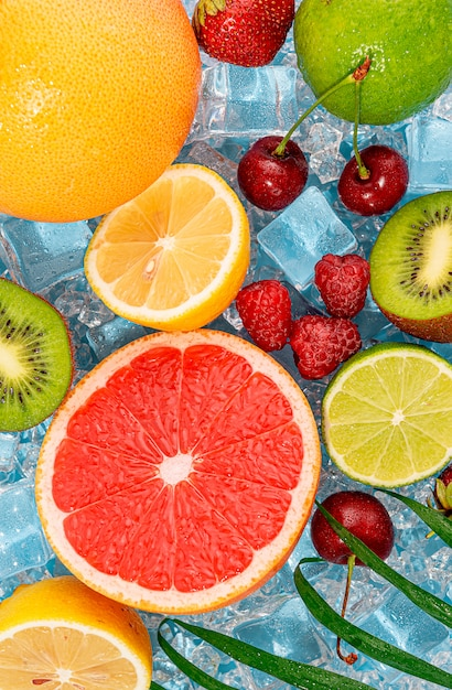 Juicy fresh fruit on ice. concept of cool drinks in the summer heat Premium Photo