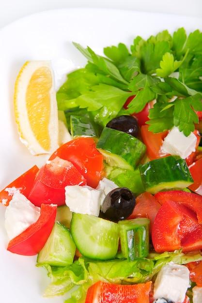 Juicy fresh greek salad in white bowl Premium Photo