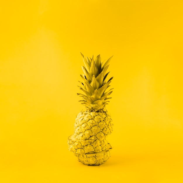 Juicy pineapple on yellow background Free Photo