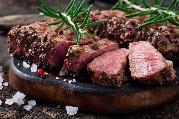Juicy steak medium rare beef with spices Premium Photo