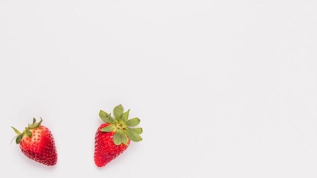 Juicy strawberries on white background Free Photo
