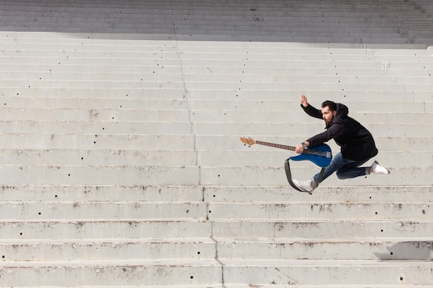 Jumping guitarist Free Photo