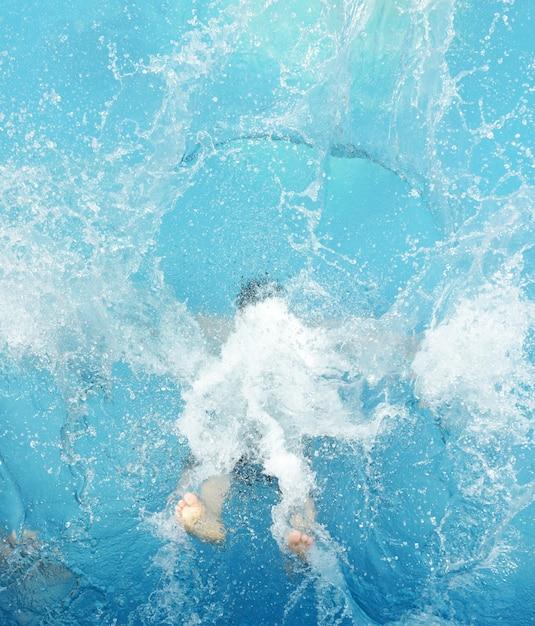 Jumping splash into the summer water pool Premium Photo
