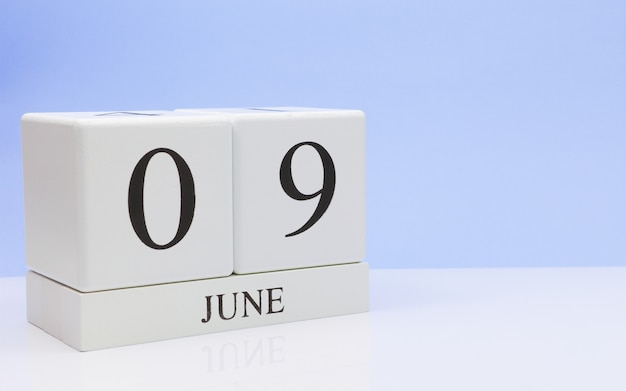 June 09st. day 9 of month, daily calendar on white table Premium Photo