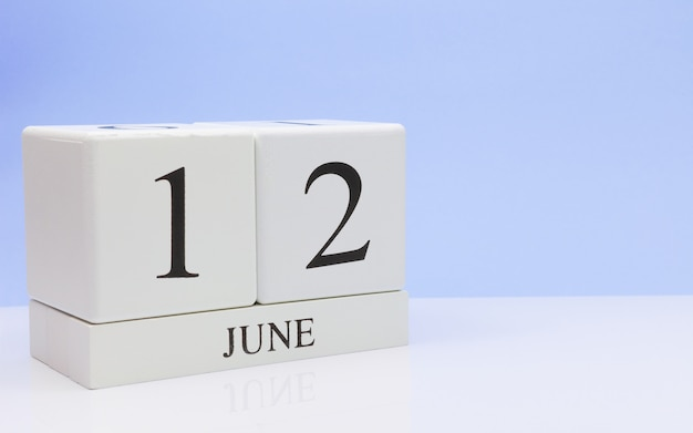 June 12st. day 12 of month, daily calendar on white table Premium Photo