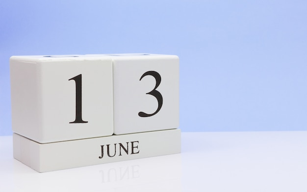 June 13st. day 13 of month, daily calendar on white table Premium Photo