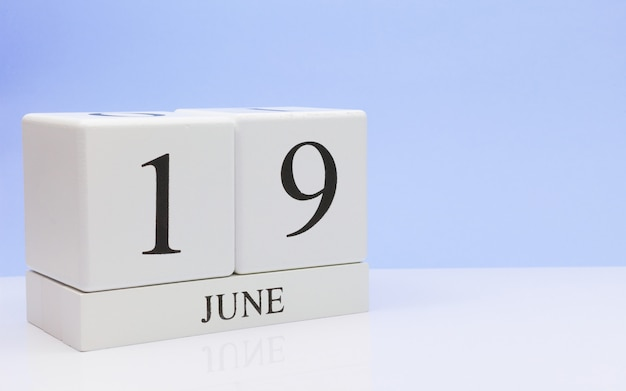 June 19st. day 19 of month, daily calendar on white table Premium Photo