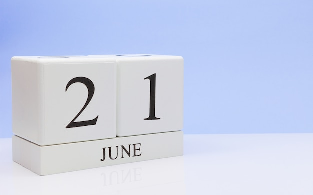 June 21st. day 21 of month, daily calendar on white table Premium Photo