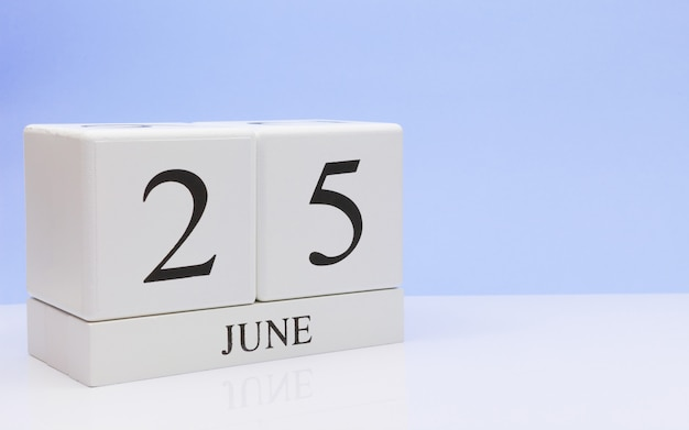 June 25st. day 25 of month, daily calendar on white table Premium Photo