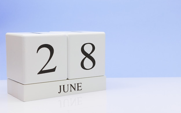 June 28st. day 28 of month, daily calendar on white table Premium Photo