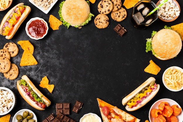 Junk food on black slate with copy space Free Photo