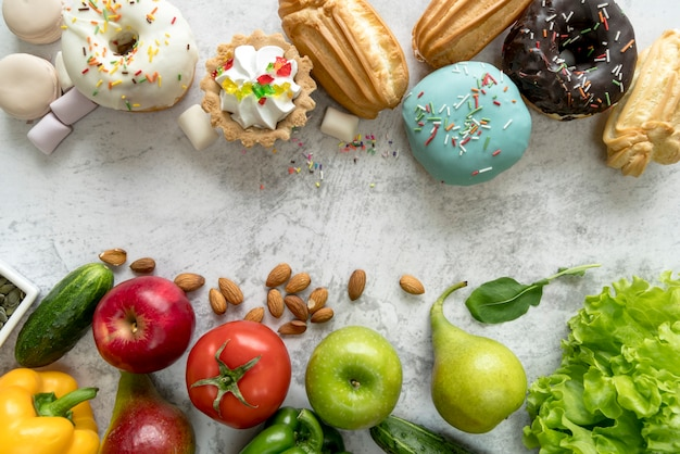Junk food and healthy food on old concrete background Free Photo