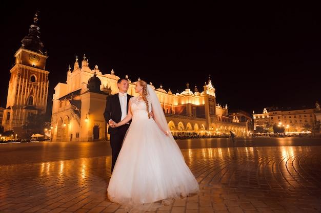 Just married couple night city walk Free Photo