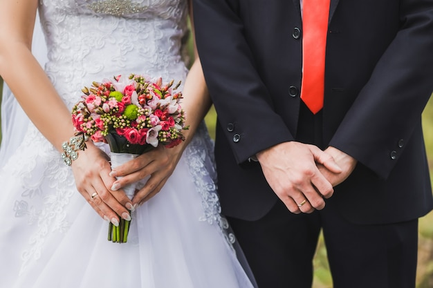 Just married standing side by side. Premium Photo
