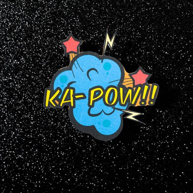 Ka pow comic expression vector text on glittering dark background Free Photo
