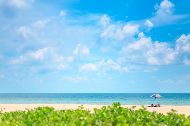 Ka-ron beach at phuket , thailand. sand beach with beach umbrella. summer, travel, vacation and holiday concept. Premium Photo