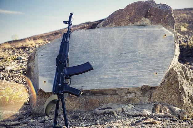 Kalashnikov assault rifle close-up on a background of granite slabs Premium Photo